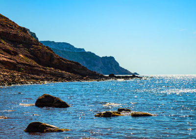 Alghero, Sardinia, taly - Panoramic view of the Cala Porticciolo gulf with cliffs over the Cala Viola gulf in the Porto Conte Regional Park