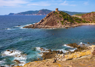 Alghero, Sardinia, Italy - Panoramic view of the Cala Porticciolo gulf with Torre del Porticciolo tower in the Porto Conte Regional Park